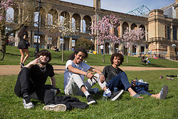 © Licensed to London News Pictures.30/03/2021. Brighton,UK. Members of the public enjoy spring weather in Alexandra Park, north London. Temperatures are expected to rise with highs of 23 degrees forecasted for parts of London and South East England today . Photo credit: Marcin Nowak/LNP
