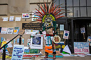 Member of the Aztec Dance Group in front of the EPA's Washington D. C. headquarters after the Climate March.