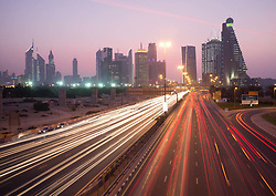 Busy traffic on Sheikh Zayed Road at dusk in Dubai in United Arab Emirates