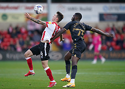 Lincoln City's Jamie Robson (left) and Charlton Athletic's Corey Blackett-Taylor battle for the ball during the Sky Bet League One match at the LNER Stadium, Lincoln. Picture date: Saturday October 16, 2021.