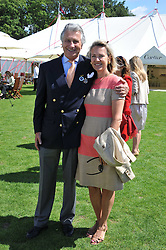 ARNAUD & CARLA BAMBERGER at the 27th annual Cartier International Polo Day featuring the 100th Coronation Cup between England and Brazil held at Guards Polo Club, Windsor Great Park, Berkshire on 24th July 2011.