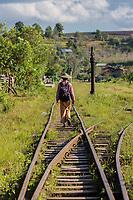 KALAW, MYANMAR - DECEMBER 06, 2016 : man local tribe walking on a railroad track near Kalaw Shan state in Myanmar (Burma)