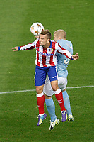 Atletico de Madrid´s Griezmann (L) and Malmo´s Tinnerholm during Champions League soccer match between Atletico de Madrid and Malmo at Vicente Calderon stadium in Madrid, Spain. October 22, 2014. (ALTERPHOTOS/Victor Blanco)