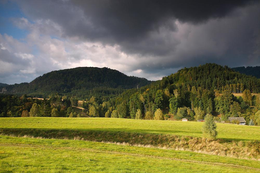 POPULATION AND NATIONAL PARK BEHIND.<br /> JETRICHOVICE. CESKE SVYCARSKO. CZECH REPUBLIC.
