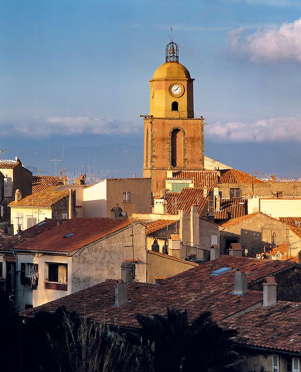 The clock tower in St. Tropez collects the evening sun on the Riviera in southern France.