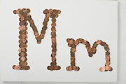Amerian English Alphabet as Constructed in Pennies on White Background for Easy Clipping
