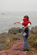 A woman and her niece explore the coastal bluffs near Crescent City, California
