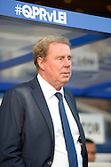 Queens Park Rangers manager Harry Redknapp in the dugout before k/o.Barclays Premier league match, Queens Park Rangers v Leicester city at Loftus Road in London on Saturday 29th November 2014.<br /> pic by John Patrick Fletcher, Andrew Orchard sports photography.