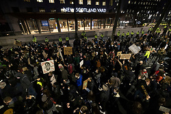 © Licensed to London News Pictures. 15/03/2021. London, UK. Protesters gather outside Scotland Yard as anger continues over the policing of Saturday's Sarah Everard vigil at Clapham Common in south London. Photo credit: Peter Macdiarmid/LNP