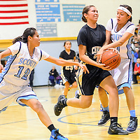 010713  Adron Gardner/Independent<br /> <br /> Driving Chinle Wildcat Cailey Lujan (34) center is contested by Window Rock Scouts Shariya Betsoi (12), left, and Keezia Owens (11) in Fort Defiance Tuesday.