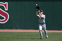 26 April 2014:   Dyllin Mucha pulls in a fly ball during an NCAA Division 1 Missouri Valley Conference (MVC) Baseball game between the Southern Illinois Salukis and the Illinois State Redbirds in Duffy Bass Field, Normal IL