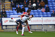 Jordan Clark of Accrington in action with Bolton Wanderers Dennis Politic during the EFL Sky Bet League 1 match between Bolton Wanderers and Accrington Stanley at the University of  Bolton Stadium, Bolton, England on 29 February 2020.