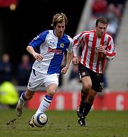 Photo: Jed Wee.<br />Sunderland v Blackburn Rovers. The Barclays Premiership. 25/03/2006.<br /><br />Blackburn's Morten Gamst Pedersen (L) attacks.