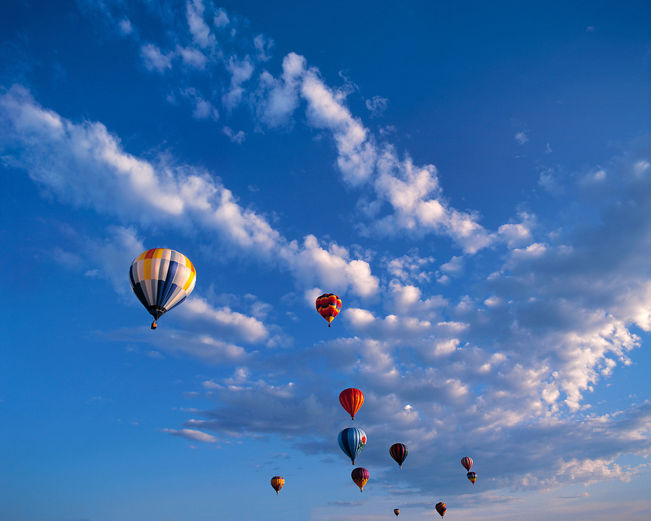 Hot-air balloons seem in competition with the clouds above Teton Valley in eastern Idaho.