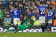 Oldham Athletic players look on as Oldham Athletic goalkeeper Daniel Iversen (1) saves a penalty from Fulham forward Aleksandar Mitrovic (9) during The FA Cup 3rd round match between Fulham and Oldham Athletic at Craven Cottage, London, England on 6 January 2019.