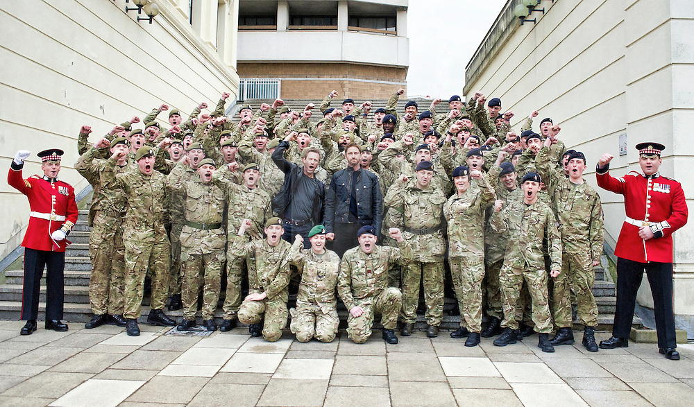 """Hollywood actors Gerard Butler and Aaron Eckhart join soldiers from F Company the Scots Guards in a 'Sparta salute'.  Butler met the soldiers at Wellington Barracks in Central London ahead of a special preview screening of Hollywood movie Olympus Has Fallen, released 17th April 2013. ..The actors spent time talking to the soldiers prior to the troops watching a special preview of the film in the barracks.  Commenting on meeting the men and women from the various Guards regiments Aaron Eckhart stated:..""""Wow, what an honour! They're a great bunch of guys!""""...NOTE TO DESKS: .MoD release authorised handout images. .All images remain crown copyright. .Photo credit to read - Sergeant Alison Baskerville RLC"""