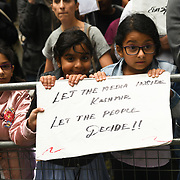 Hundreds Kashmiris protest India terrorists and Indian army occupation revoke article 370 and 35A. The same language Israel apartheid in Palestine outside India Embassy London, How can a human being do harm to this beautiful children? on 20 August 2019, UK.