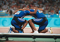 Great Britain Gold Medalists celebrate together at track side. Jason Gardener,Marlon Devonish,Darren Campell and Mark Lewis Francis.Mens 4 X 100 Relay Final.28/8/2004.Athens Olympics 2004. Credit : Colorsport/Andrew Cowie.