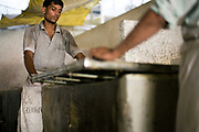 Workers making paper by hand at a factory in Sanganer, Jaipur, India