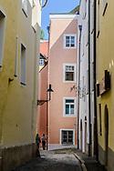 Couple wialing down a norrow street, Passau Germany