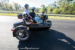 Skyler Keim-Jones, a Florida MDA goodwill ambassador, gets a ride in a Harley sidear model during Annual MDA Ladies Run to Destination Daytona sponsored by Harley-Davidson every year on the Tuesday of Daytona Beach Bike Week. FL, USA. March 10, 2015.  Photography ©2015 Michael Lichter.