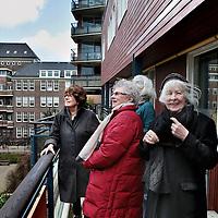 Nederland, Amsterdam , 1 april 2015.<br /> Bewoners van woongroep Stadskruid in de Tweede Constantijn Huygestraat.<br /> Foto:Jean-Pierre Jans