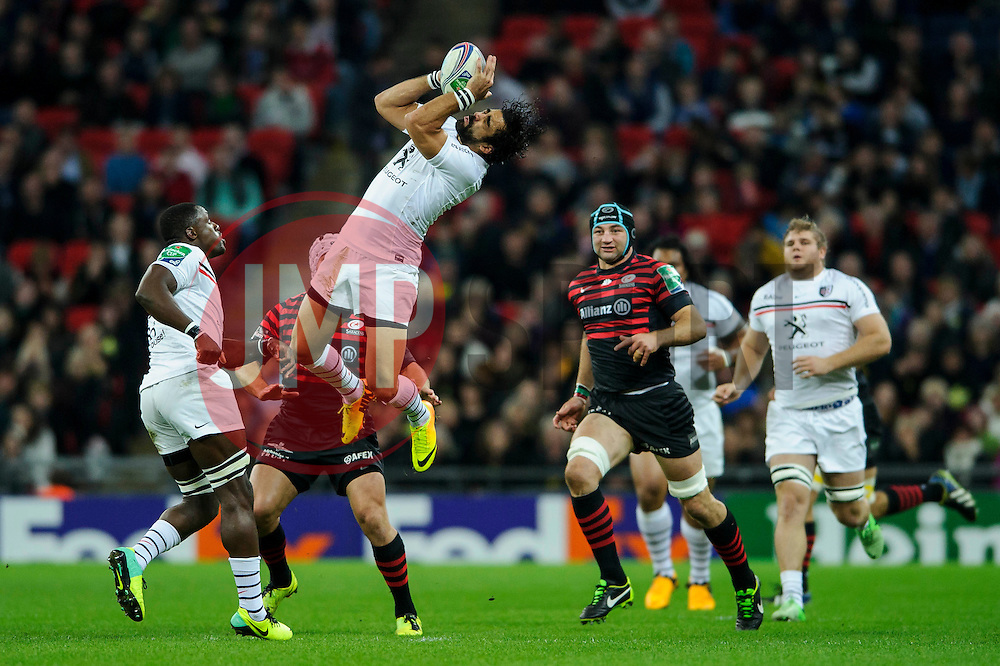 Toulouse Winger (#14) Yoann Huget competeSaracens in the air for a high ball during the first half of the match - Photo mandatory by-line: Rogan Thomson/JMP - Tel: 07966 386802 - 18/10/2013 - SPORT - RUGBY UNION - Wembley Stadium, London - Saracens v Toulouse - Heineken Cup Round 2.