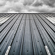 Monochrome Image of Roof Cladding under a dramatic sky.