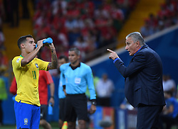 ROSTOV-ON-DON, June 17, 2018  Philippe Coutinho (L) of Brazil drinks water during a group E match between Brazil and Switzerland at the 2018 FIFA World Cup in Rostov-on-Don, Russia, June 17, 2018. (Credit Image: © Li Ga/Xinhua via ZUMA Wire)