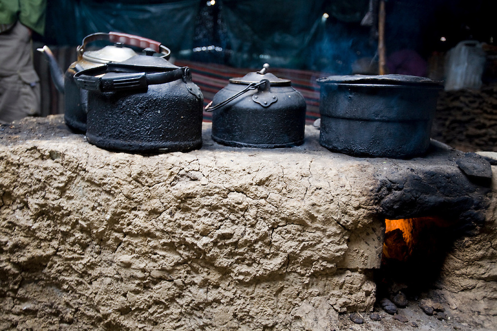 The dung-fired hearth in Karsal's kitchen at their home in the Tibetan Plateau.  (Karsal is featured in the book What I Eat: Around the World in 80 Diets.)  The nomadic herder's family uses dung collected from the yak and dri pastures for cooking and keeping their house warm.