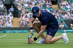 LONDON, ENGLAND - Tuesday, July 2, 2019: A ball boy opens a new tin of balls during the Ladies' Singles first round match on Day Two of The Championships Wimbledon 2019 at the All England Lawn Tennis and Croquet Club. (Pic by Kirsten Holst/Propaganda)