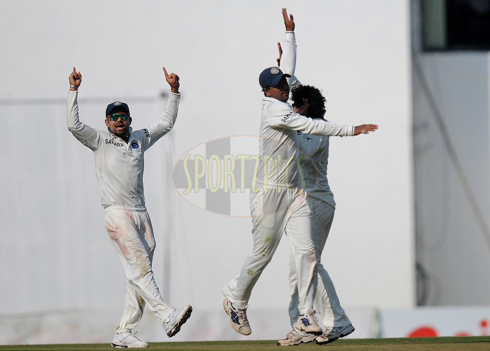Ravindra Jadeja of India celebrates with teammates after taking the wicket of Kevin Pietersen of England during day one of the 4th Airtel Test Match between India and England held at VCA ground in Nagpur on the 13th December 2012..Photo by  Pal Pillai/BCCI/SPORTZPICS .