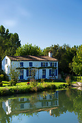 Quaint picturesque house by River La Sevre-Niortaise in Coulon in the Marais Poitrevin region, Grand Site de France