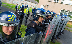South Queensferry,, Scotland, UK. 16th September 2021. Police Scotland invite the press to witness their ongoing public order training at Craigiehall Camp at South Queensferry. The training is designed to prepare police for the upcoming COP26 event in Glasgow in November where protests are anticipated. Police in riot gear faced up  against police taking the role of protesters throwing missiles and attacking them with clubs.  Iain Masterton/Alamy Live News.
