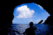 Sea kayaking in a cave along the Na Pali Coast, Island of Kauai, Hawaii USA