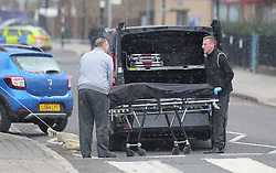 © Licensed to London News Pictures, 17/03/2018. London. UK, Undertakers remove the body of the young man who was shot in South Street, Enfield,  Photo credit: Steve Poston/LNP