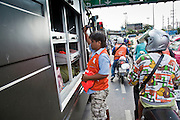 14 MAY 2010 - BANGKOK, THAILAND: Anti government protesters vandalize a Thai army riot control truck at the intersection of Rama IV and Witthayu Roads in Bangkok Friday morning. Tensions among Red Shirt protesters demanding the dissolution of the current Thai government rose overnight after Seh Daeng, the Red Shirt's unofficial military leader was shot in the head by a sniper. Gangs of Red Shirts have taken over military checkpoints on Rama IV and are firing small rockets at military helicopters and army patrols in the area. Troops have responded by firing towards posters.  PHOTO BY JACK KURTZ