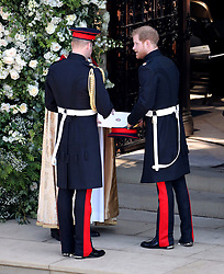 Prince Harry (right) and the Duke of Cambridge arrive for the wedding of Prince Harry and Meghan Markle at Windsor Castle.