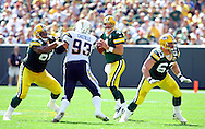 Green Bay Packers' Brett Favre is protected by Junius Coston and Scott Wells before Favre completed a 16-yard pass to Donald Driver in the 2nd quarter. .The Green Bay Packers hosted the San Diego Chargers at Lambeau Field in Green Bay Sunday September 23, 2007. Steve Apps-State Journal.