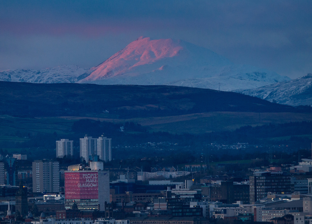 Ben Lomond lit up pink with the last rays of the setting sun. In the foreground is Glasgow City Centre with a pinkCollege of Printing Picture Robert Perry 14th Feb 20<br /> <br /> Please credit photo to Robert Perry<br /> <br /> FEE PAYABLE FOR REPRO USE<br /> FEE PAYABLE FOR ALL INTERNET USE<br /> www.robertperry.co.uk<br /> NB -This image is not to be distributed without the prior consent of the copyright holder.<br /> in using this image you agree to abide by terms and conditions as stated in this caption.<br /> All monies payable to Robert Perry<br /> <br /> (PLEASE DO NOT REMOVE THIS CAPTION)<br /> This image is intended for Editorial use (e.g. news). Any commercial or promotional use requires additional clearance. <br /> <br /> Copyright 2016 All rights protected.<br /> first use only<br /> contact details<br /> Robert Perry     <br /> 07702 631 477<br /> robertperryphotos@gmail.com<br />   <br /> Robert Perry reserves the right to pursue unauthorised use of this image . If you violate my intellectual property you may be liable for  damages, loss of income, and profits you derive from the use of this image.