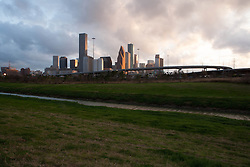 Houston, Texas skyline and bayou in the foreground at dusk.