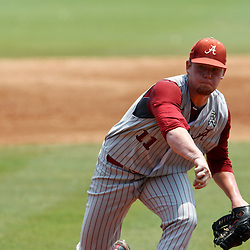 June 06, 2011; Tallahassee, FL, USA; Alabama Crimson Tide pitcher Trey Pilkington (11) throws against the Florida State Seminoles during the seventh inning of the Tallahassee regional of the 2011 NCAA baseball tournament as play resumed following the suspension of play due to severe weather last night at Dick Howser Stadium. Florida State defeated Alabama 11-1 to advance to a super regional.  Mandatory Credit: Derick E. Hingle