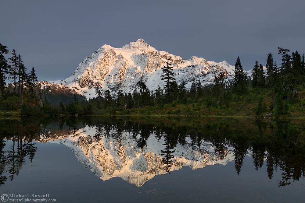 Evening light on Mount Shuksan and the Fall colors at  Picture Lake in the Mount Baker-Snoqualmie National Forest, Washington State, USA