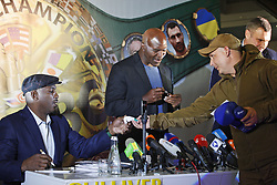 October 2, 2018 - Kiev, Ukraine - Former Boxing Champion LENNOX LEWIS (L) and former Boxing Champion EVANDER HOLYFIELD (C) presents his signatures to Ukrainian soldiers who participated fighting in the eastern Ukraine, during an authographs session for supporters at the 56th World Boxing Convention in Kiev, Ukraine, on 2 October 2018.The WBC 56th congress in which take part boxing legends Evander Holyfield,Lennox Lewis, Eric Morales and about 700 participants from 160 countries runs in Kiev from from September 30 to October 5. (Credit Image: © Serg Glovny/ZUMA Wire)