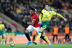 Anthony Martial of Manchester United Kenny McLean of Norwich City battles for possession- Mandatory by-line: Phil Chaplin/JMP - 27/10/2019 - FOOTBALL - Carrow Road - Norwich, England - Norwich City v Manchester United - Premier League
