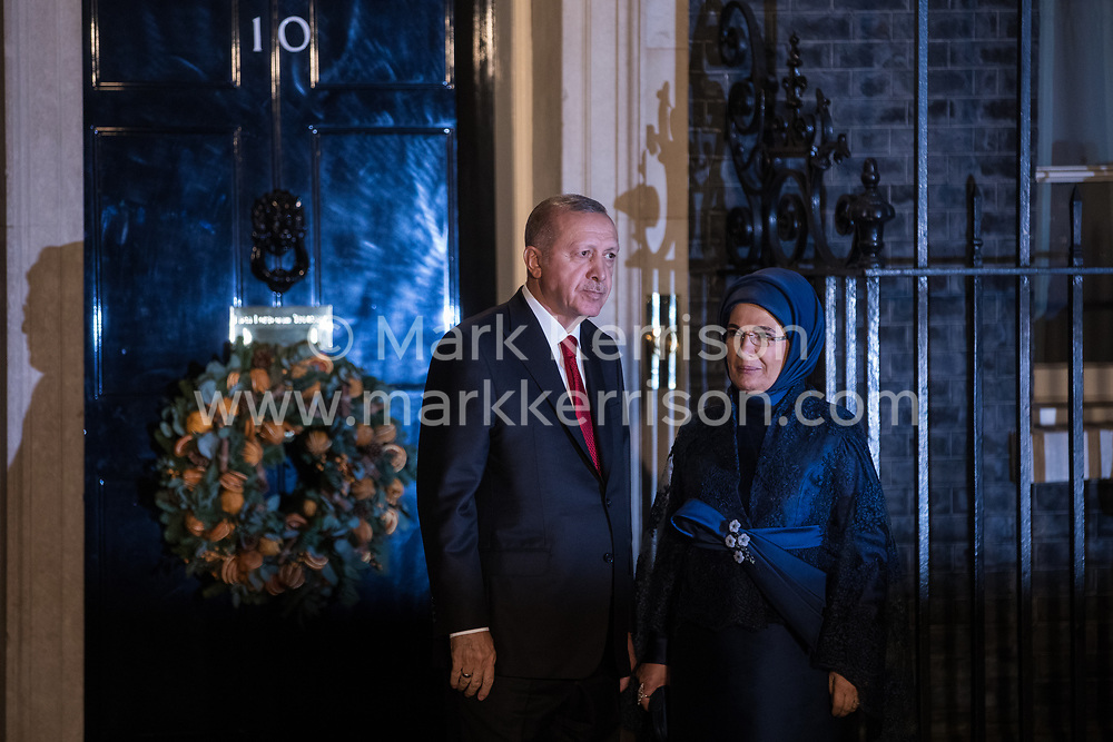 London, UK. 3 December, 2019. Recep Tayyip Erdoğan, President of Turkey, arrives with his wife Emine Erdoğan for a reception for NATO leaders at 10 Downing Street on the eve of the military alliance's 70th anniversary summit at a luxury hotel near Watford.