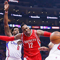 14 May 2015: Houston Rockets center Dwight Howard (12) vies for the loose ball with Los Angeles Clippers center DeAndre Jordan (6) and Los Angeles Clippers forward Matt Barnes (22) during the Houston Rockets 119-107 victory over the Los Angeles Clippers, in game 6 of the Western Conference semifinals, at the Staples Center, Los Angeles, California, USA.