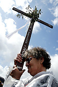 Worshipper hold a cross during a procession at the Catholic Fatima shrine in central Portugal 13 May 2005. Thousands of pilgrims converged on Fatima to celebrate the anniversary of the first apparition of the Virgin Mary to three shepherd children on 13 May 1917.PHOTO PAULO CUNHA/4SEE