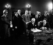 29/03/1976<br /> 03/29/1976<br /> 29 March 1976<br /> Petroleum exploration licences signed at Iveagh House, Dublin. Minister for Industry and Commerce, Mr Justin Keating T.D. and senior oil company executives representing the firms to which licences were being granted signed petroleum exploration licences in respect of exploration offshore of Ireland. Image shows The Minister (seated right) signing the licence with Mr. P. Guillaumat, Chairman , Elf Aquitaine, representing the Elf Aquitaine Group, including Net and ERGAS.  On left is<br /> Mr J.C. Holloway, Assistant Secretary, Dept. of Industry and Commerce with Padraig O'Slatarra, Secretary, Dept. of Industry and Commerce on right.
