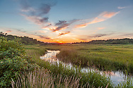 A peaceful sunset over the marsh that surrounds Wing's Island.